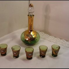 50abf30e9ec Green glass decanter shot glasses made Italy Vintage green glass decanter  with 5 shot glasses. Made in Italy the gold trim has some wear .