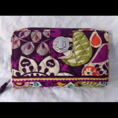 """Vera Bradley turn lock wallet NWOT Vera Bradley turn lock wallet in pattern """"plum crazy"""". Only used a handful of times. Great condition and smoke free home. Dimensions 7¾"""" x 4¾"""" Vera Bradley Bags Wallets"""