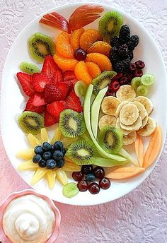 Food Art Pretty fruit tray platter with dip. Fruit Dip Recipe 1 4 oz. Cream Cheese 1/2 cup Sour Cream 1 7 oz. Jar Marshmallow Crème Mix together...Chill...serve with fruit Mandarin oranges, strawberry, pineapple, blueberry, red and green grapes, cantaloupe, honey dew melon, bananas, blackberry, raspberry, and kiwi.