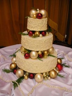 THIS for a Christmas wedding cake! I love the ornaments in between!!! Check out the blog for other winter wedding decoration ideas, including: snowflakes | blanket chair covers | berries | pine cones | candles | feathers | baby's breath flowers | Christmas lights | fairy lights | sleds | stocking silverware pockets | sweater vases | crystals | wedding planning | wedding ideas | winter decor | www.templesquare.com/weddings/blog