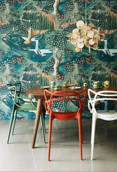 I love the color of these chairs. Heals AW/2012 collection   Zoffany Verdure wallpaper by Melissa White, BAU pendant light, Kartell Masters chairs by Philippe Starck.