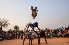 Members of the Iris group in Bissau practice before the Carnaval competition to judge the best teams in the city of Bissau region. Photo by Ricci Shryock @ricci_s February 5, 2016. #carnaval #bissau #gymnastics #guineabissau #flips #sunset #everydayeverywhere #everydayafrica #fujixt1 #ricci_s