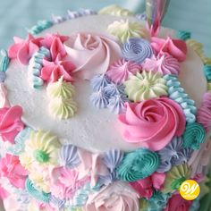 Create a literal bouquet of buttercream flowers with this Spring Floral Cake. Using very simple piping techniques, like rosettes, dots, stars and more, this cake is blossoming with bright spring colors. Best Buttercream Frosting, Buttercream Flowers, Cake Icing, Butter Icing Cake Designs, Buttercream Cake Designs, Buttercream Birthday Cake, Fondant Cake Designs, Icing Flowers, Cake Flowers