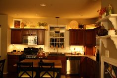 I love her mood lighting under and above the cabinets. The only way to light up a kitchen. I wish all builders automatically did this for us. Bravo! Love it! (I did mine too!)