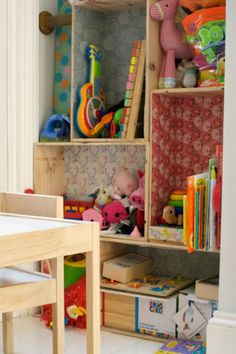 Patterned cubbies- Stacked wooden boxes  with patterned paper. Such an attractive storage solution!