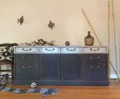Using CeCe Caldwell's Chalk + Clay Paint in Vermont Slate for the lower portion, Girl In Blue Designs created a modern buffet that would be perfect to use during holiday meals.