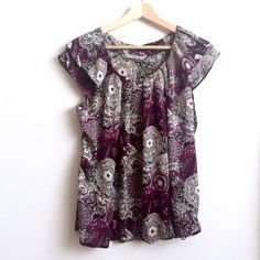 Larry Levine Purple Paisley Blouse This listing includes a cute paisley blouse with cap sleeves. Made out of a silky material. In excellent condition. No size listed, but I would say it is closest to a size Medium. The brand is Signature by Larry Levine. Macy's Tops Blouses