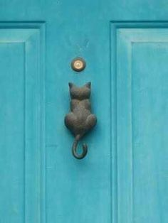 cat door knocker. This one has his back turned on the viewer,