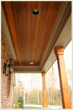 Nice warm-toned tongue and groove for porch ceiling -- love the stain color and overall look of this. We would also like to apply this to the small ceiling area of the roof extension above our garage. Porch Columns, House With Porch, House Front, Cedar Paneling, House Exterior, House Columns, Exterior Design, Porch Remodel, House Designs Exterior