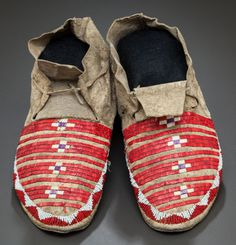 American Indian Art:Beadwork and Quillwork, A PAIR OF SIOUX QUILLED AND BEADED HIDE MOCCASINS. c. 1890... Image #1