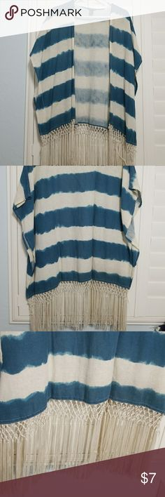 Bohemian Shrug Blue and white striped throw over, with fringe at the bottom. Super cute, boho style. Light material. There is some discoloration, shown in the final picture, from storage and the nature of the fabric. Definitely not noticeable when on! Tons of life! Perfect for a pop of color, or to throw over a swimsuit at the beach for some boho summer selfies! Smoke free home. Forever 21 Sweaters Shrugs & Ponchos