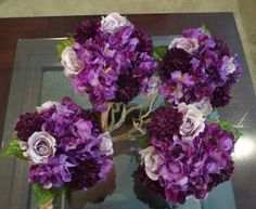 Hydrangeas, Roses and Mums in a hand tied Bridesmaid bouquets in Shades of Purple, violet and lavander.                      This is Silk....Savannah Event Decor