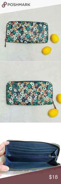 "Floral Zip Up Wallet Orange & Blue Retro Design -Excellent used condition- a little bit of corner wear -One main compartment, zipper coin pouch, and 4 card slots and money slot Please note measurements for size comparisons: -W 4"" -L 8"" -D 1""  -Polyester vinyl easy clean exterior -No brand or tags -Navy blue, mint green, orange, and cream (colors' appearance may vary on screen)  Questions? Just ask! Bundle to save!  Offers welcome  Happy Poshing! Bags Wallets"