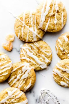 These lemon ginger cookies are made with candied ginger and fresh lemon zest. They're soft and chewy with crisp edges and sweet lemon glaze on top. Recipe on sallysbakingaddiction.com