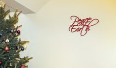 """Focus on Christmas 2013 - """"Peace on Earth"""" on the wall near the Christmas tree is from P.Graham Dunn in Dalton, Ohio"""