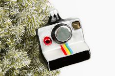 Photojojo Tree Bling - The Photojojo Store!  Then I would have almost every camera in the form of an ornament