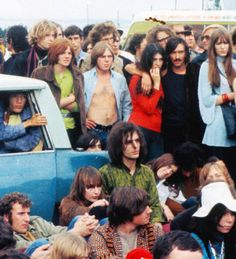 Syd Barrett (green shirt in front of car) at the Isle of Wight festival1969