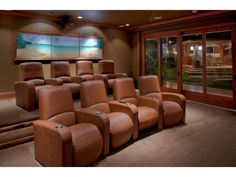 A incredible home theater with immaculate leather movie theater seats and access to the home's outdoor living space. Kailua, HI Coldwell Banker Pacific Properties