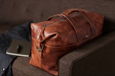 (via Octovo Leather Goods « Airows)  Another great leather duffle bag that is sure to serve you well for years to come, becoming more and more authentic as it goes through every journey with you.