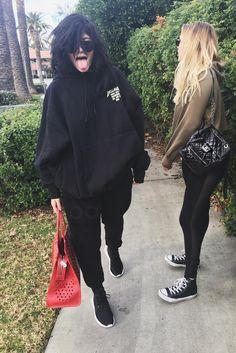 Kylie Jenner wearing Sorella Tidal Wave Sunglasses, Adidas Tubular Defiant Sneakers , Fan Merchandise Kanye Yeezys Glastonbury Hoodie, Goyard Hardy Pet Carrier