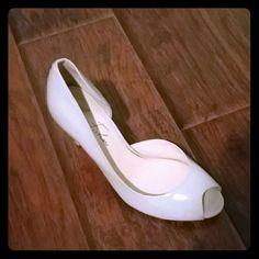 Nude heels Peep toe heels. Cream/nude colored with 3 1/2 inch heel. Very comfortable :) Marc Fisher Shoes Heels