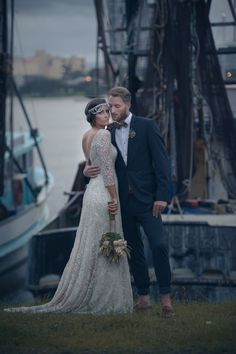 amazing wedding dress and a daper, casual grooms suit