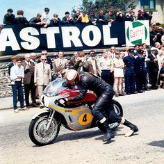 Mike Hailwood push starting his Honda RC181 at the Isle of Man Senior TT, 1967.