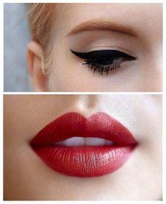black winged eyeliner + deep red lipstick.