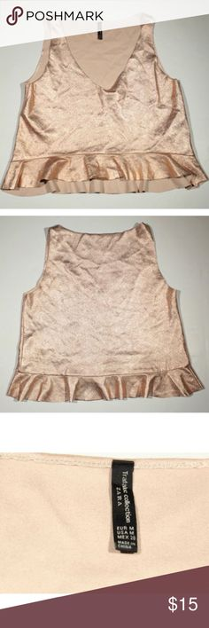 ZARA Trafaluc Collection Sleeveless Crop Top ZARA Trafaluc Collection Sleeveless Rose Gold Metallic Crop Top Size Medium  Excellent used condition with no stains, marks, or tears.  Gorgeous peplum crop top. This is a slightly heavier slick texture.  Approximate measurements:  Pit to pit: 19 inches  Length: 19-21.5 inches  Fast shipping from Colorado!  Thank you for viewing! Trafaluc Tops Crop Tops