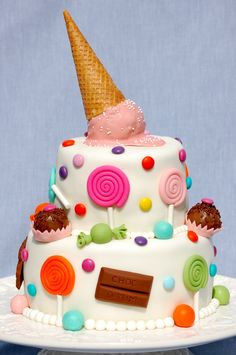 Candy Cake! Fondant-covered carrot cake with cream cheese frosting. Fondant candy and M&Ms. The ice cream 'accident' is a...