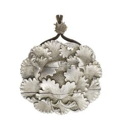 A silver two-case inro Attributed to Unno Shomin, late Meiji Period In the form of a peony bloom, each windblown petal finely and realistically rendered, the interior with a carved signature Hinoe saru banshu Shomin koku (carved by Shomin in late Spring, Year of the Monkey [1896]), with fitted wood storage box, the interior of the lid inscribed with an attestation dated August 1906 that the piece was made by the Imperial Court Artist Unno Shomin, a professor at the Tokyo Art School.