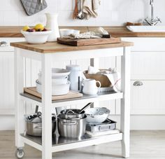 The sleek STENSTORP kitchen cart gives you extra storage, utility and work space when you need it.