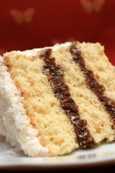 Mounds Bar Cake - Heaven on a Plate!!!~T~ A coconut cream cake with a Mounds Bar filling and Coconut Frosting.
