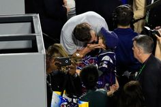 Tom Brady Photos Photos - Tom Brady #12 of the New England Patriots celebrates defeating the Seattle Seahawks with his wife Gisele Bundchen and son Benjamin during Super Bowl XLIX at University of Phoenix Stadium on February 1, 2015 in Glendale, Arizona. The Patriots defeated the Seahawks 28-24. - Super Bowl XLIX - New England Patriots v Seattle Seahawks