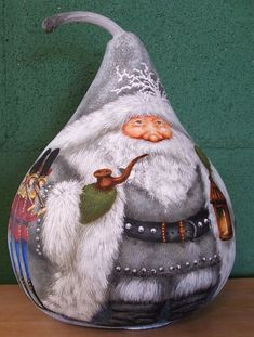 Another favorite of mine, this jolly, green eyed Santa boasts a grey suit with white trim, adorned with silver bells and frosty branches. He carries a charming, rustic lantern, and smokes a fat bowled fairie pipe. The children of this home must truly be remarkable to receive such