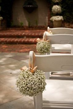 babies breath wedding, love the way they hung these on the pews