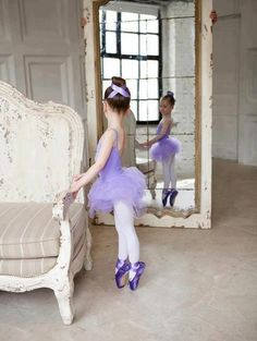little ballerina in purple dress