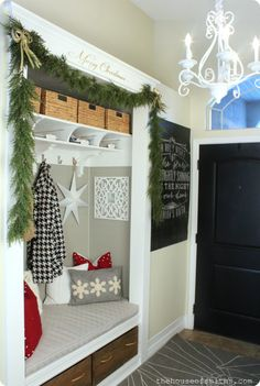 Love the door painted black & I love the coat cubby! The House of Smiths - Home DIY Blog - Interior Decorating Blog - Decorating on a Budget Blog