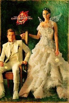 Combined photo of Katniss and Peeta! love it that they are wearing the same shades of color for the portrait!!