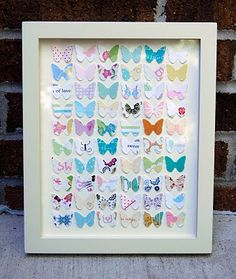 Butterfly punch outs made from wedding cards...great way to save and display. Could also make in hearts or other shapes.