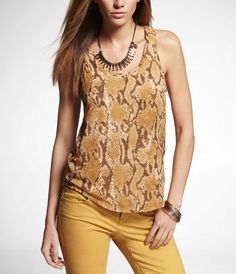 #ExpressJeans With its top layer of sheer chiffon in a hot, earthy snake print, this super-soft knit tank sets up casual chic at its simplest. Just add skinny jeans, wedges and bangles or a collar necklace.
