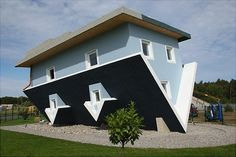 """""""The World Stands on its Head"""" (""""Die Welt Steht Kopf"""") House on the Baltic Sea Island of Usedom stands nearly completed on September 3, 2008 in Trassenheide, Germany. The upside down house, complete with upside down interior furnishings, is the brainchild of Klaudiusz Golos and Sebastian Mikiciuk, and will become a local tourist attraction that will open its doors to the public tomorrow."""