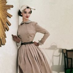 I adore double breasted mid-century dresses like this example from 1952.