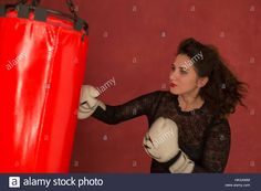 Download this stock image: Charming brunette in training in boxing. - HKXAWM from Alamy's library of millions of high resolution stock photos, illustrations and vectors.