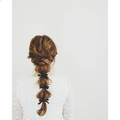 Tease crown. Low pony, leaving a piece out on left & right. Braid the left out sections & tie around ponytail elastic. Bubble pony rest of the way down, tying each section w/ a ribbon.