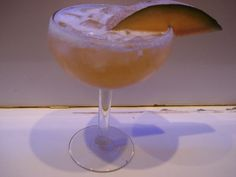 Cantoulope margarita using a fresh cantoulope puree. garnished with a cantoulope slice..  For more cocktail pictures, follow the link and like the page.  Thanks https://www.facebook.com/pages/Damien-The-Intoxicologist-Filth/187108378032348?ref=hl
