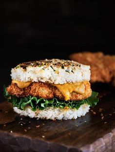 Katsu Fried Chicken and Rice Burger - Ditch the usual wheat bread bun. Crispy fried katsu chicken is served with a Japanese curry sauce and served between a chewy rice bun. | honestcooking.com