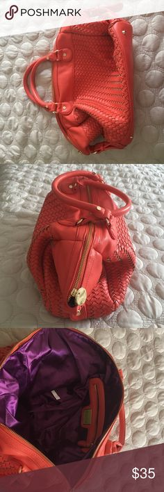 NWOT coral orange deux lux bag woven purse NWOT. Coral orange woven purse with gold hardware. Zipper top with inside zipper pocket. Measure 20 inch at top zipper. 13 inches zipper top to bottom of bag. Roomy and perfect for summer 15% off 2+ items  I have other fabulous items in my closet add this to your bundle & keep looking for bigger discounts!  Deux Lux Bags Totes