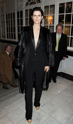 Stella Tennant in Celine coat, jumpsuit, shoes, and necklace at British Fashion Awards in London, where she won Model of the Year - Jan. 4, 2012
