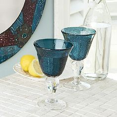 £9.99 Montjuc Glasses Pair of generous glasses for water or wine, hand-crafted to create myriad tiny air bubbles recalling the rich collection of fountains throughout the city of Barcelona.